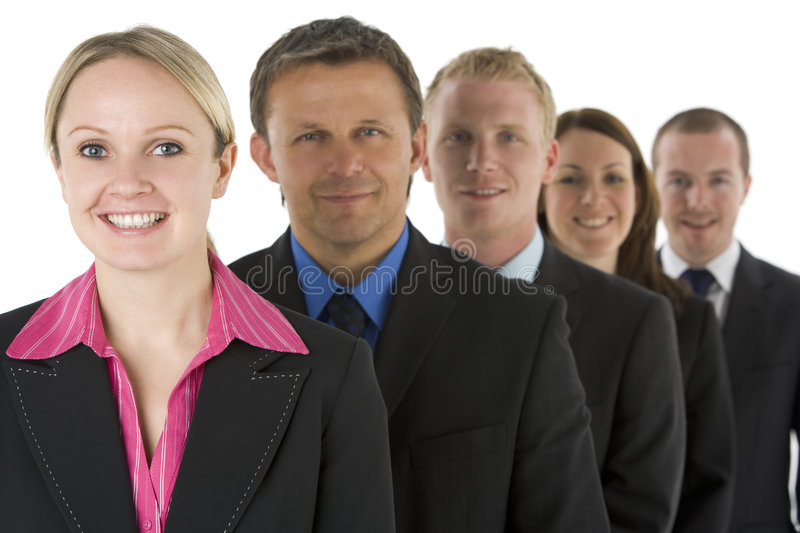 Group Of Business People In A Line Smiling royalty free stock photography