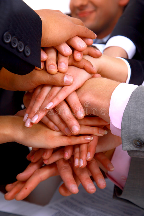 Group of business people making a pile of hands stock photos