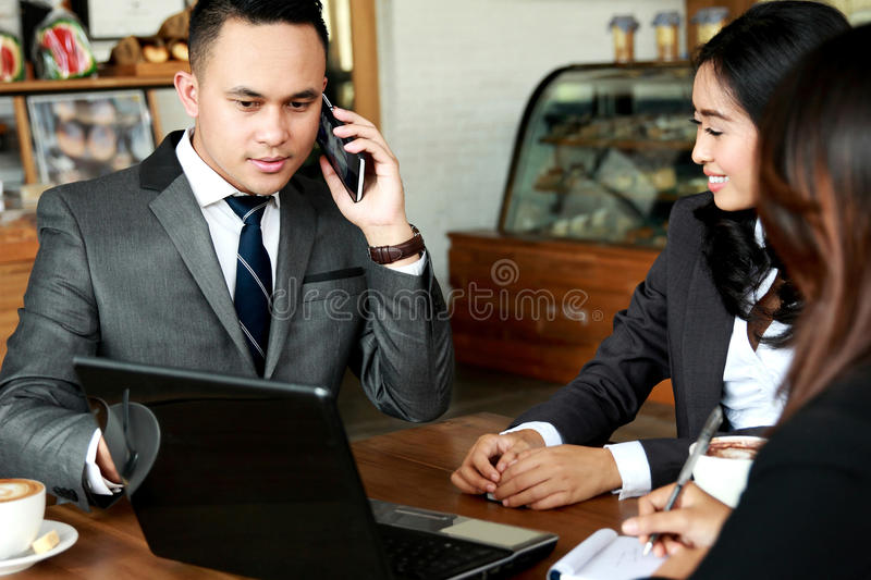 Group of business people meeting at cafe royalty free stock photos