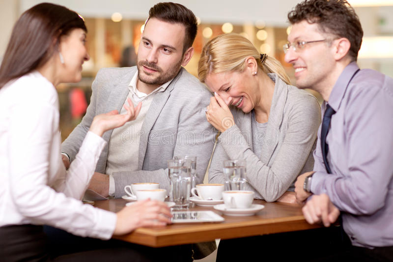 Group of business people meeting in coffee shop and holding a b royalty free stock photography