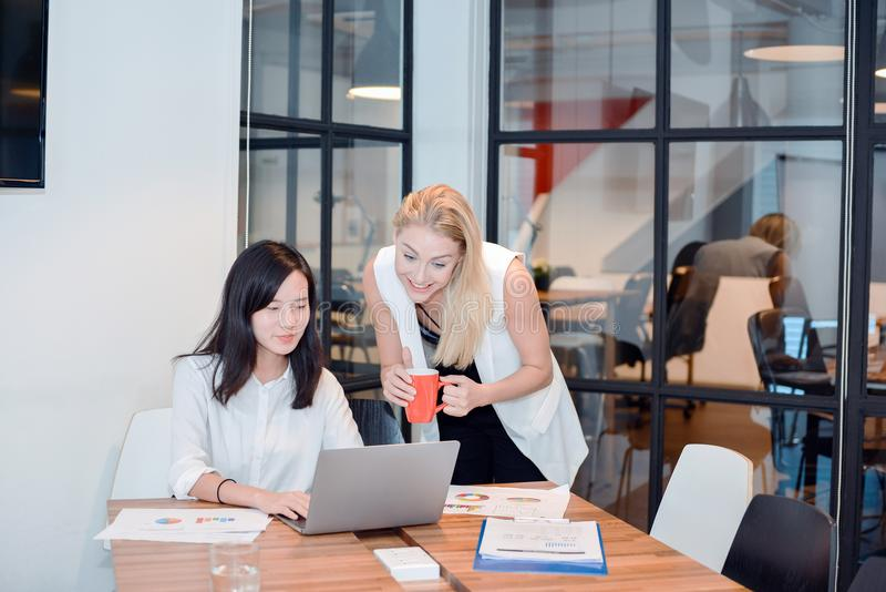 Group of business people meeting in a meeting room, sharing their ideas, Multi ethnic royalty free stock image