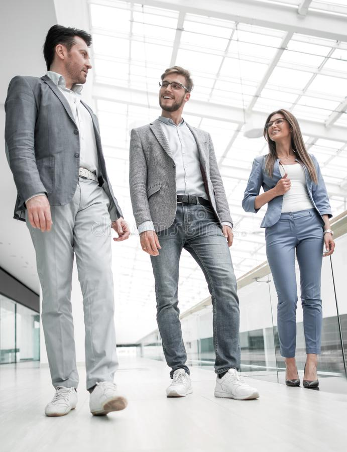 Group of business people in the office hall royalty free stock photo