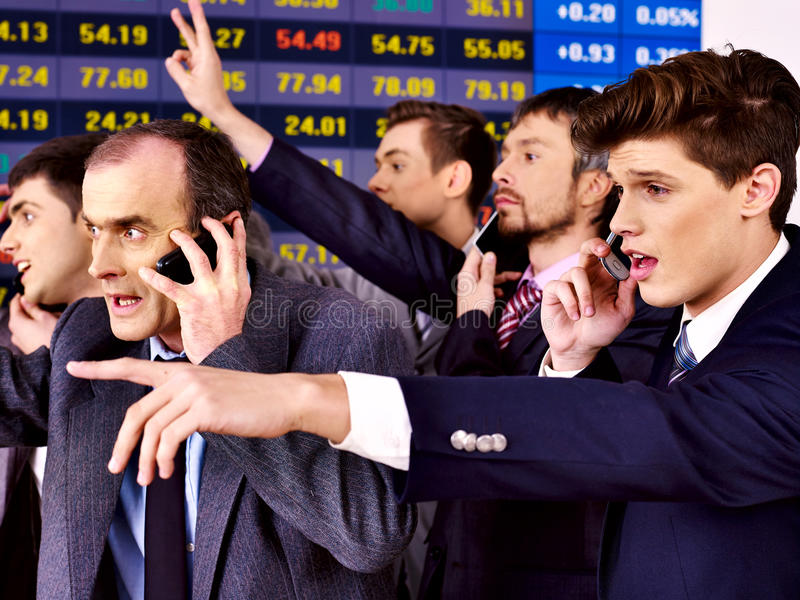 Group business people in office. Group business people with stock exchange board in office royalty free stock photo