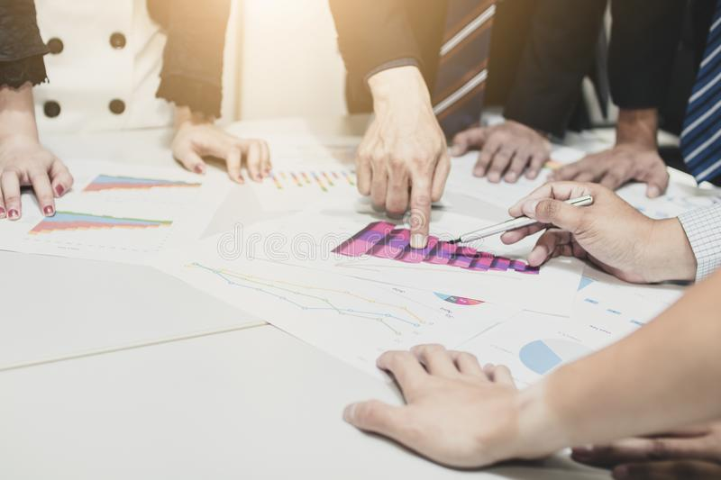Group of business people planning and analyzing in meeting tabl stock photos