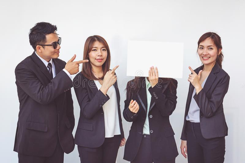 Group of business people posing with white board stock photography