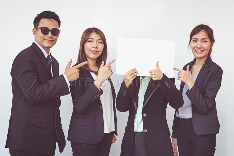 Group of business people posing with white board royalty free stock photos