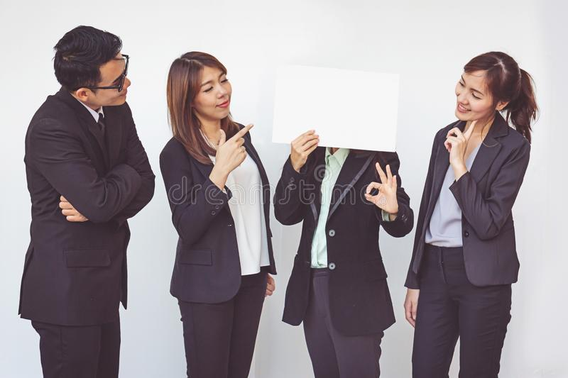 Group of business people posing with white board royalty free stock photo