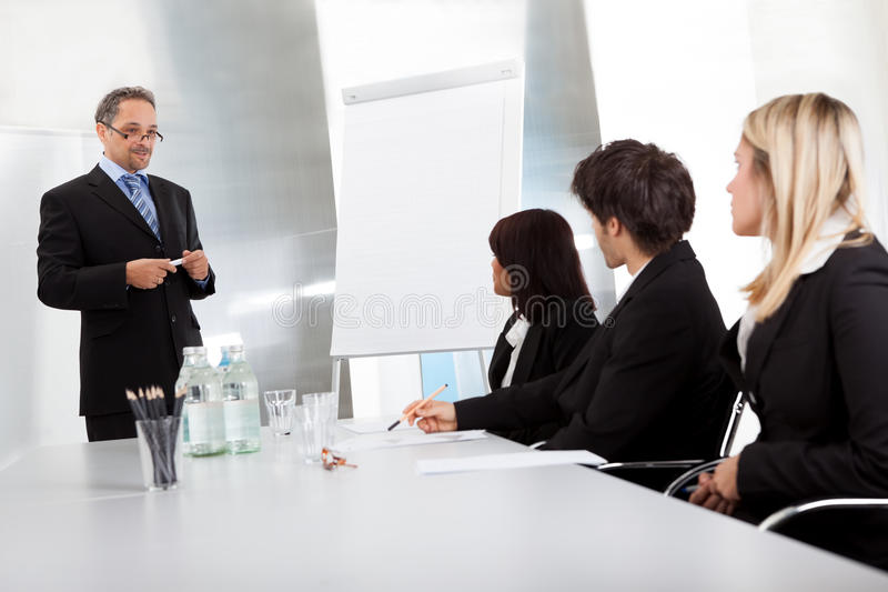 Download Group Of Business People At Presentation Stock Image - Image: 25759637