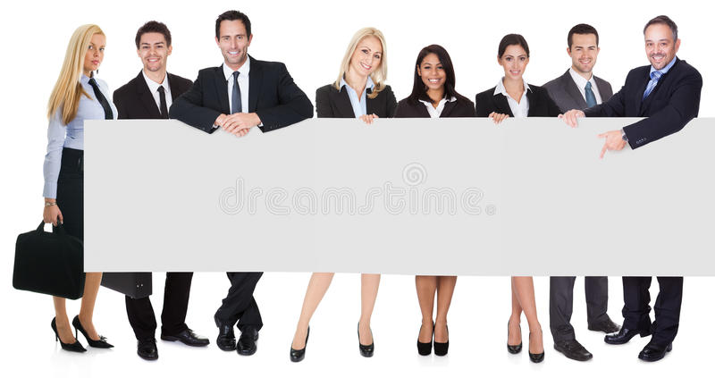 Download Group Of Business People Presenting Empty Banner Stock Photo - Image: 29516480