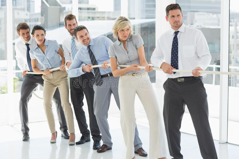Group Of Business People Pulling Rope In Office Stock Image