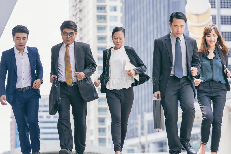Group Business people running in city. royalty free stock image