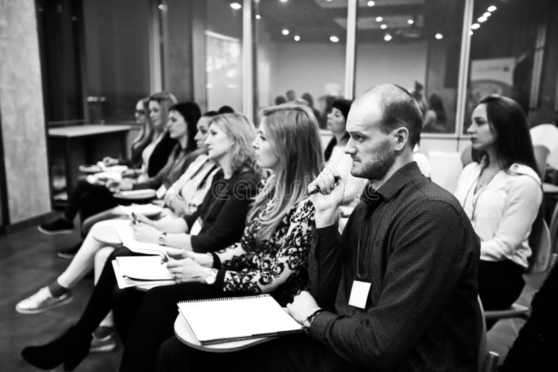 Group of business people at a seminar in the modern office. black and white photo stock photo