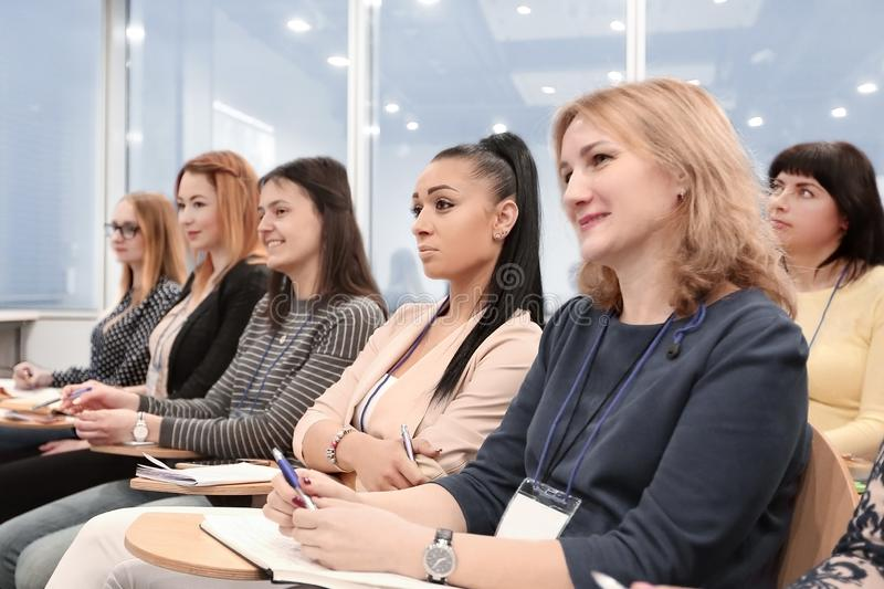 Group of business people at a seminar in the modern office stock photography