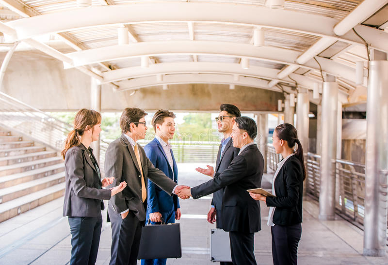 Group of Business people shaking hands, Teamwork finishing up a meetingpartners greeting each other after signing contract stock image