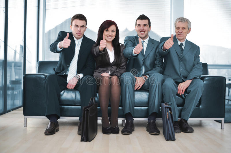 Group of business people sitting stock image
