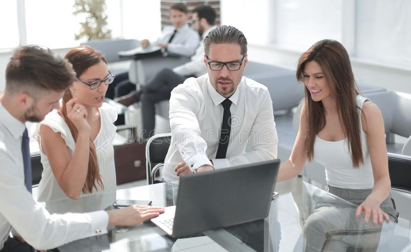 Group of business people sitting at the Desk stock photos