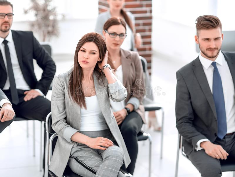Group of business people sitting in the meeting room royalty free stock photography