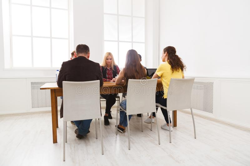 Group of business people sitting in office royalty free stock image