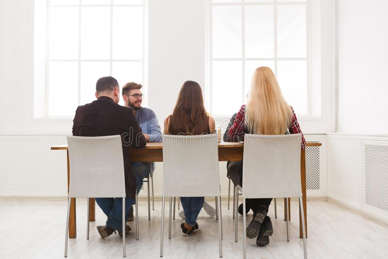 Group of business people sitting in office stock image