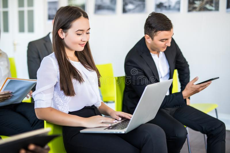 Group of business people sitting in office waiting for job interview, close-up. Conference or training concepts stock photo