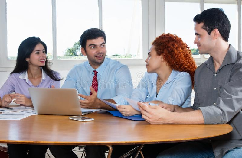 Group of business people and software developers at work. At office stock photos