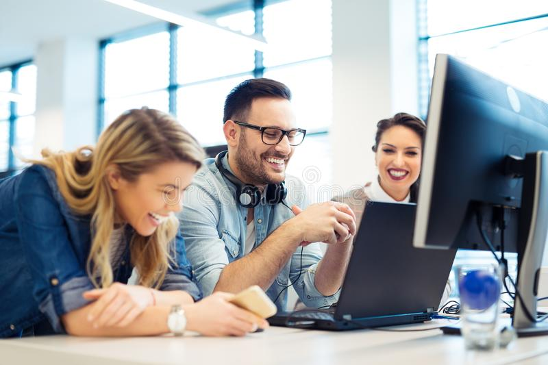 Group of business people and software developers working as a team in office stock photos