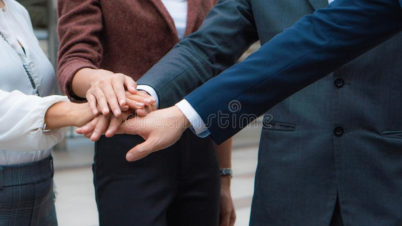 Group of business people stacking hands together to cheer up team spirit.  stock images