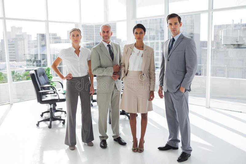 Group of business people standing in line stock photos