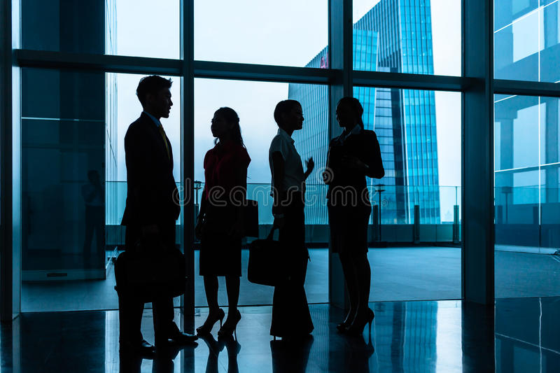Group of business people standing in lobby or hall stock images