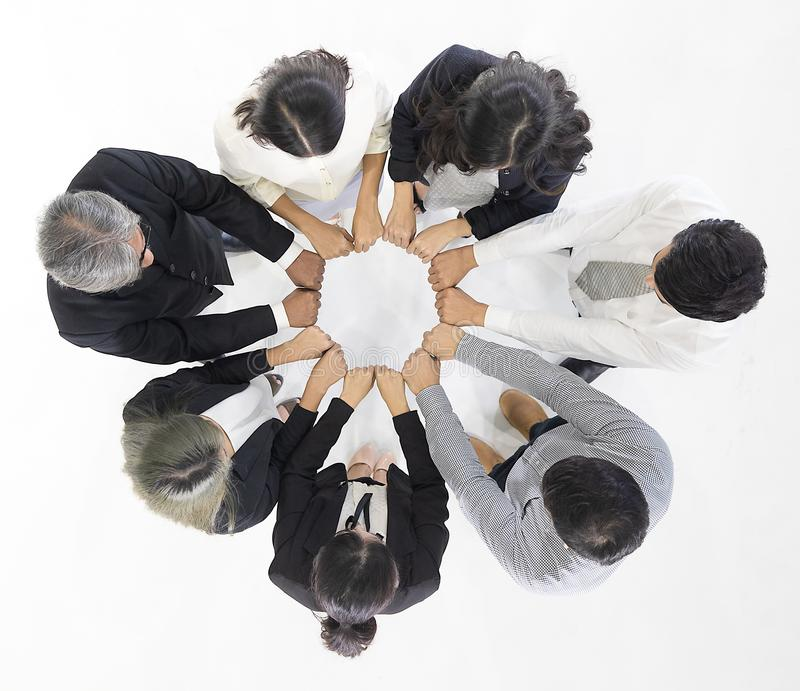 Group of business people touch their fists together in circle sh stock image