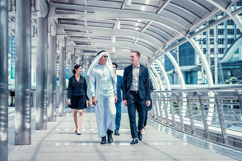 Business people walking in the city and talk about business future. multi culture of business people, African, Caucasian and Asian royalty free stock images