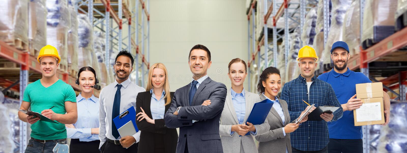 Group of business people and warehouse workers stock photo