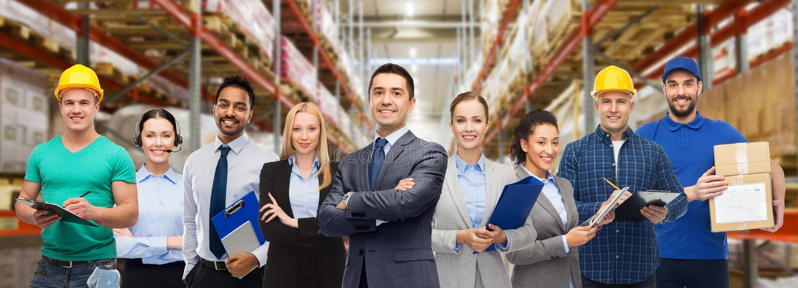 Group of business people and warehouse workers royalty free stock photos