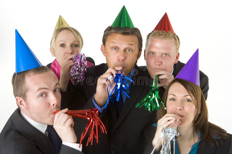 Group Of Business People Wearing Party Favors royalty free stock images