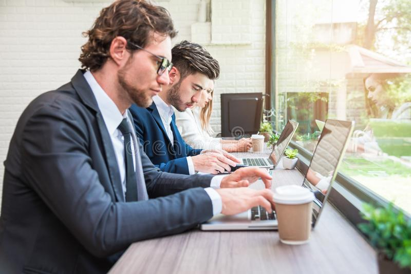 Group of business people working with modern laptops in office. Teamwork and Cooperation concept. Business worker and Salary man. Group of business people royalty free stock images