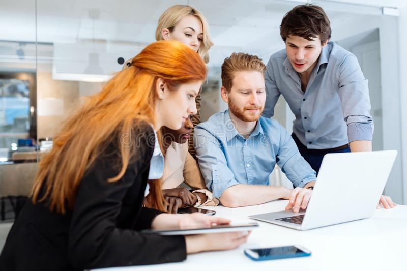 Group of business people working in office stock photo