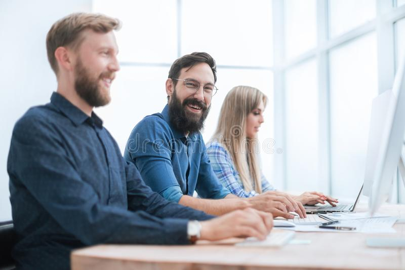 Group of business people working in the office together stock photos