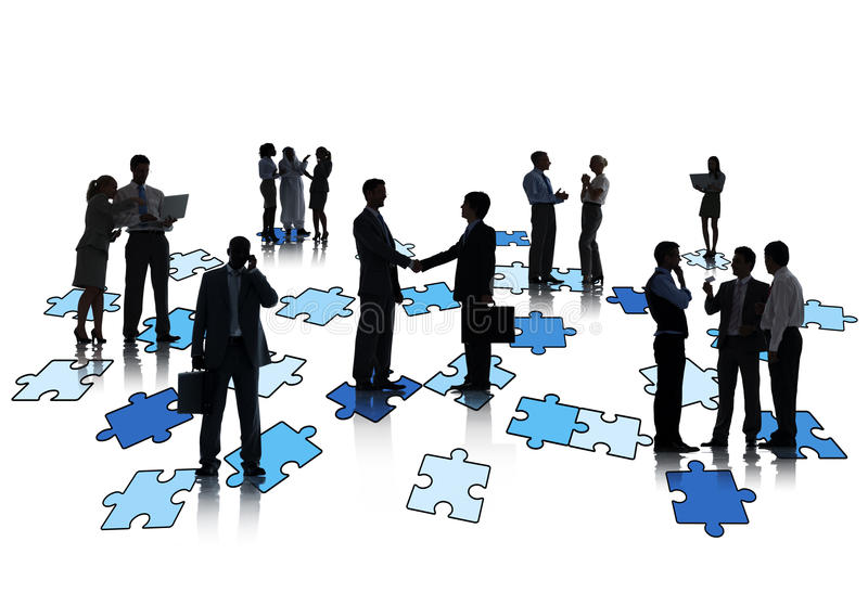 Group Of Business People Working And Standing On Jigsaw Puzzles.  royalty free stock image