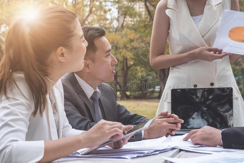 Group of business people working in team outdoors at park royalty free stock image