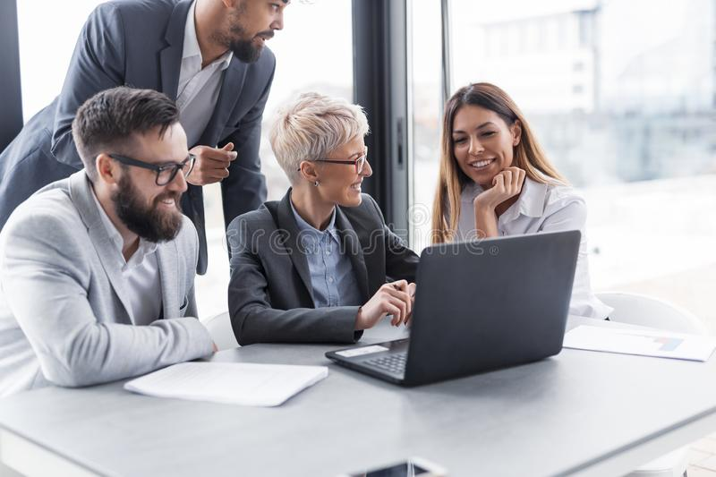 Business people working. Group of business people working together, having a brainstorming session. Focus on the women royalty free stock image