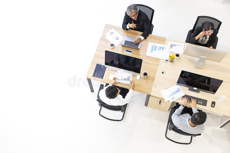 Group of business people working together in modern office,m taken from top view high angle. royalty free stock image