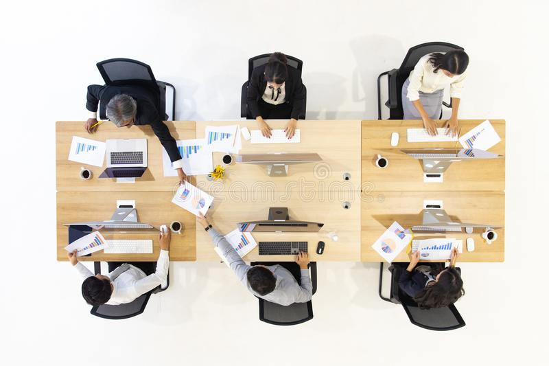 Group of business people working together in modern office,m taken from top view high angle. royalty free stock photo
