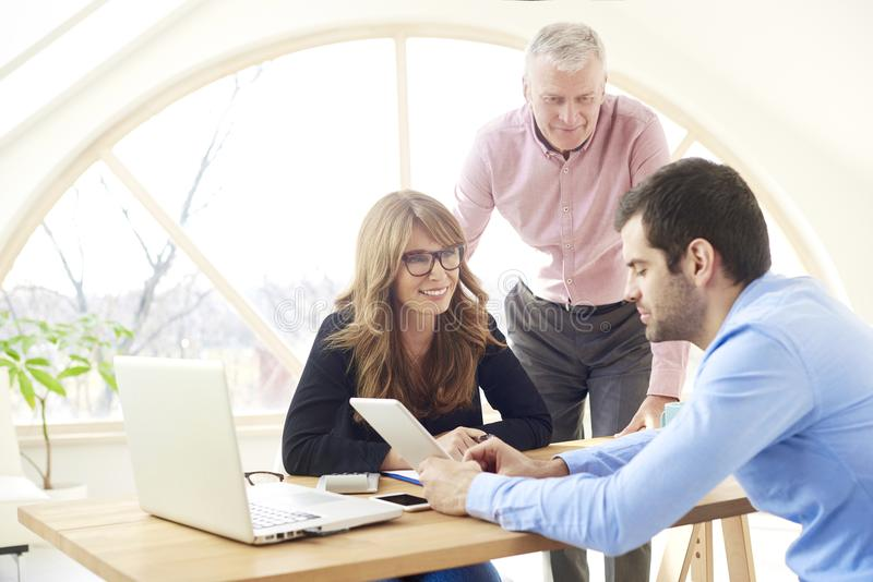 Group of business people working together on new project stock photos