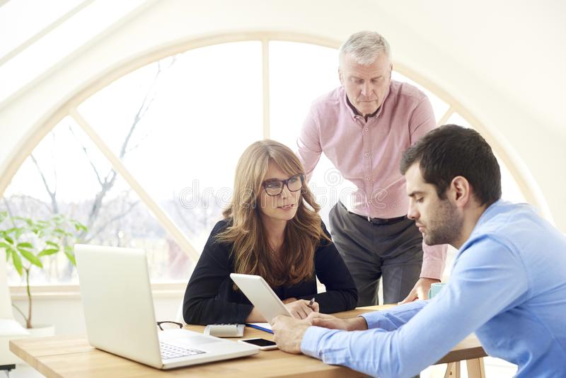 Group of business people working together on new project stock photography