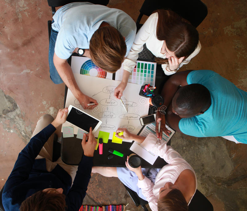 Group of business people working, top view. Loft office and smart casual dress code. Group of business people working, top view. Loft office and smart casual stock photo