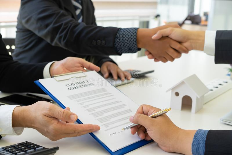Group of business peoples signing contract and shaking hands after successful projects royalty free stock photo