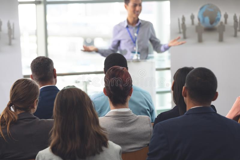 Group of business professionals attending a seminar royalty free stock image