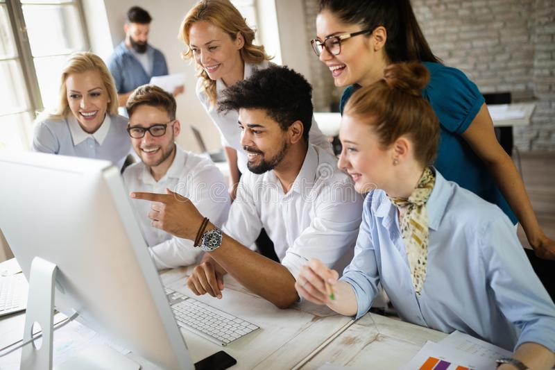 Group of business professionals having a meeting. Diverse group of designers smiling at the office. royalty free stock image