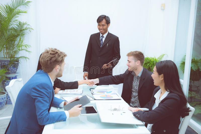 Group of business team people shaking hand with success, agreement of discussion with handshake after meeting in stock image