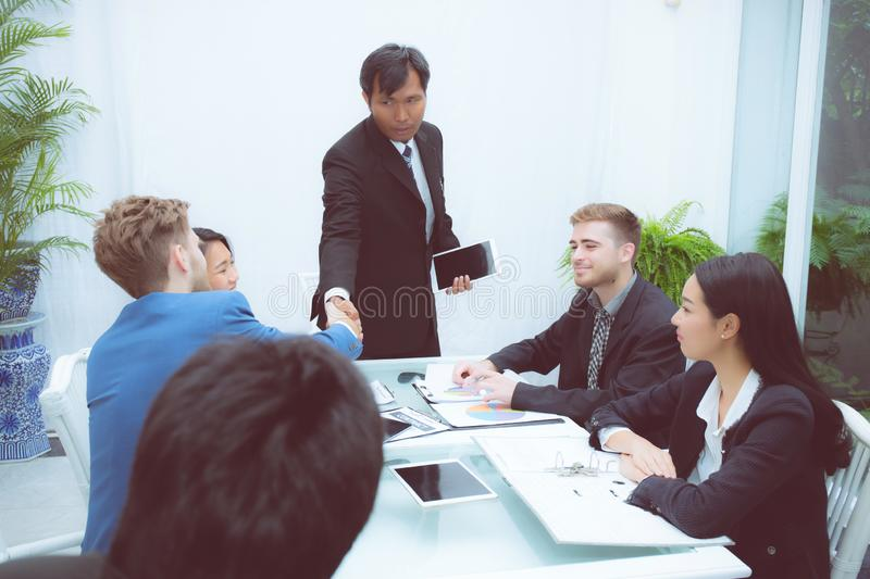 Group of business team people shaking hand with success, agreement of discussion with handshake after meeting in royalty free stock photo